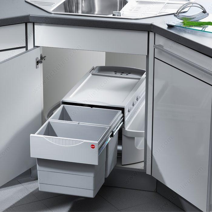Centre de recyclage et de rangement de produits de for Rangement pour armoire de cuisine en coin